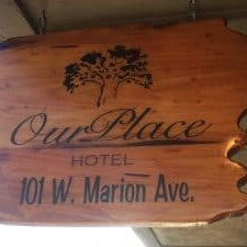 Our Place Hotel Sign